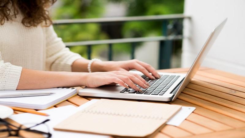 woman_writing_at_laptop.jpg
